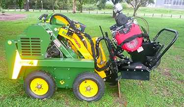Kanga loader with stump grinding attachment.